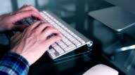 Man typing in a Mac Apple keyboard. video
