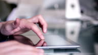 Man typing in an iPad tablet. video