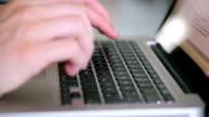 Man typing in an Macbook Laptop. video