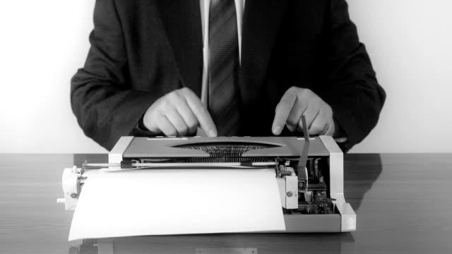 Man typing on a manual typewriter video