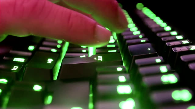 Man typing on green keyboard of an office computer. video