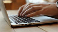 man typing on laptop computer video