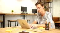 Man Typing on Laptop Keyboard in Modern Loft Office video