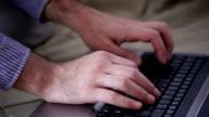 Man typing on laptop keyboard video