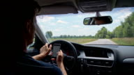 SLO MO Man typing SMS while driving video