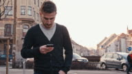 MS Man Typing SMS While Walking In The City video