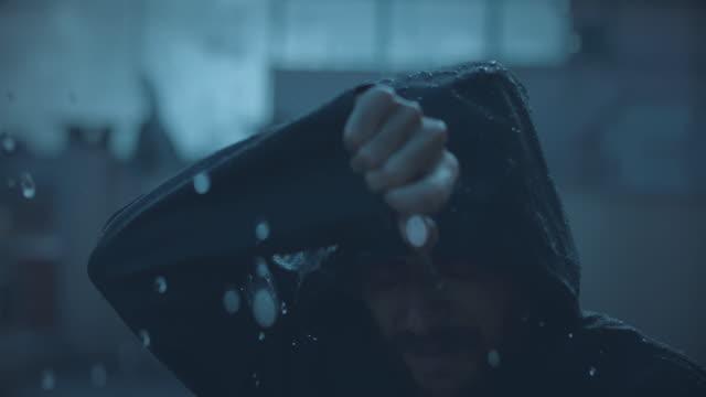 Man under a heavy rain video