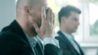 Man under stress at work. Corporate business video