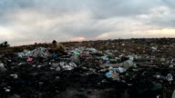 man unemployed homeless dirty looking food waste in landfill dump  social video video