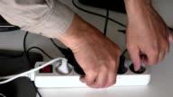 Man unplugging electrical plugs video