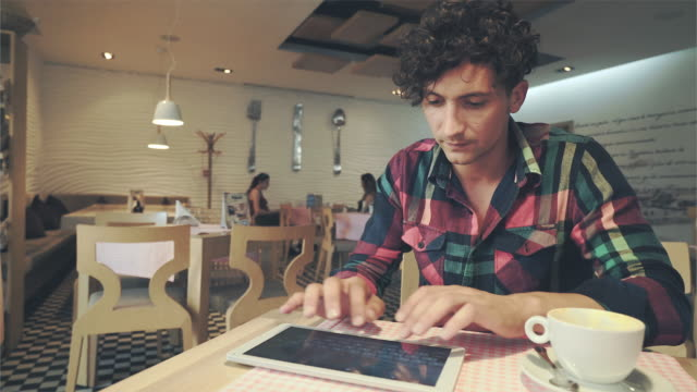 Man using a digital in a cafeteria. video