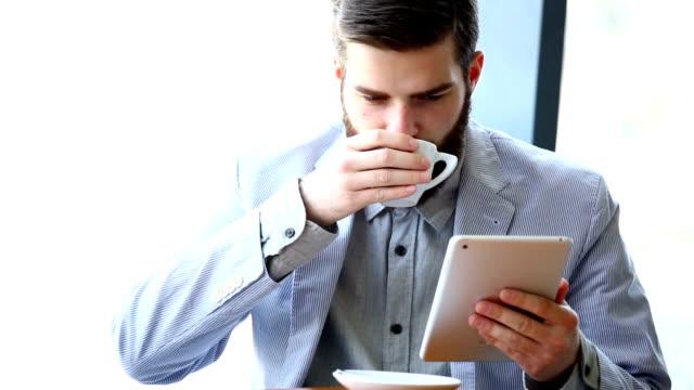 Man using a digital tablet. video