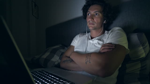Man using a laptop late in night. video
