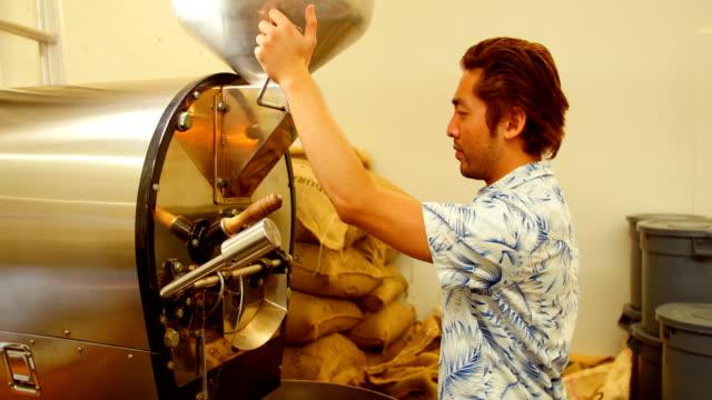 Man using coffee grinding machine video