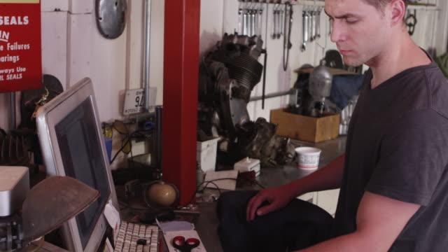 Man using computer in workshop video