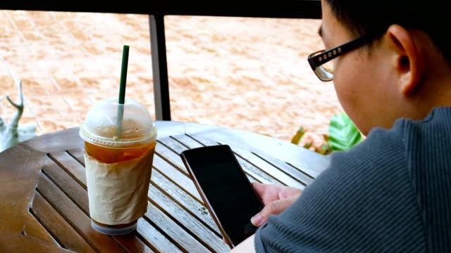 Man using digital smart phone in coffee shop video