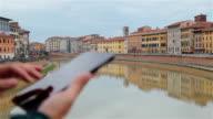 Man Using Digital Tablet of River Arno Pisa Italy. video