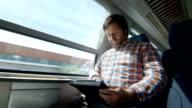 HD: Man Using Digital Tablet On A Train video