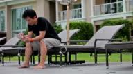 Man using digital tablet outdoor video