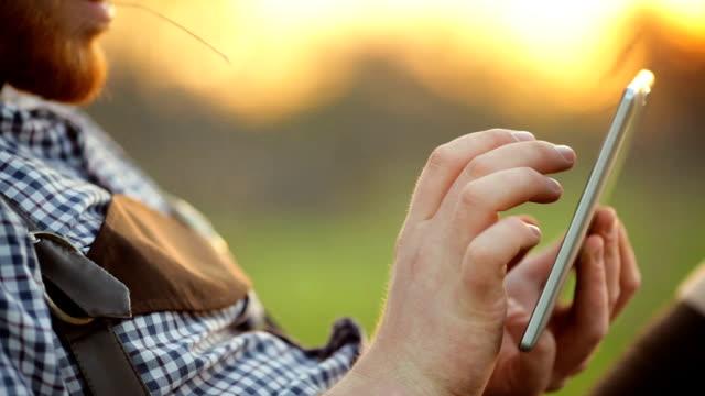 Man Using Digital Tablet. Outdoors video