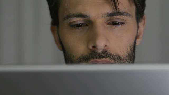 Man using digital tablet video