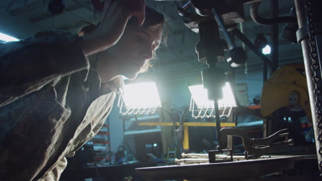 Man Using Drill Press video