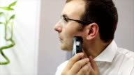 Man using electric shaver video