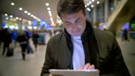 Man using electronic tablet at the station video