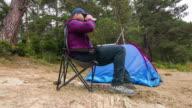 Man using laptop at campground video