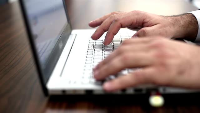 Man using laptop computer video
