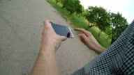 Man using navigation app on the mobile phone video