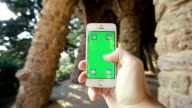 Man Using Phone in Natural Grotto, Parc Guell video