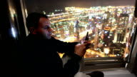 Man using phone on cityscape view in Dubai video