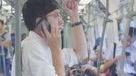 Man Using Smart Phone In Subway video