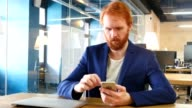 Man Using Smartphone at Work, Red Hairs video