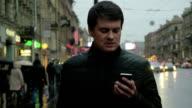 Man using smartphone on the street video