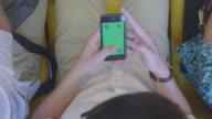 Man using smartphone on train,Green screen video