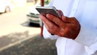 Man using smartphone video