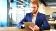 Man Using Tablet in Office, Red Hairs video