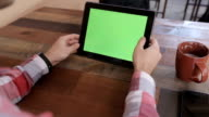 Man Using Tablet PC in Landscape Mode at Home.Tablet with Green Screen.Causal Lifestyle. video