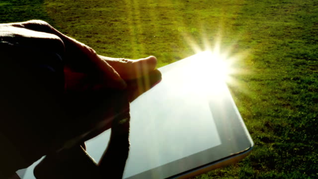Man using tablet pc outdoors. video