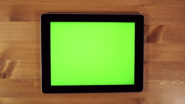 Man Using Tablet PC with Green Screen video