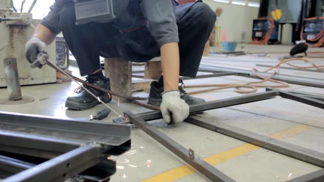 Man using welding machine in industrial factory video