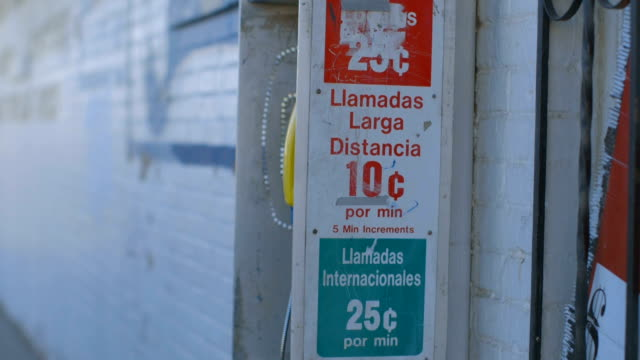 Man Waits by Pay Phone in Border Town video