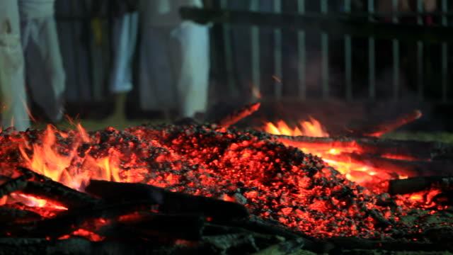 Man walk through the bonfire video