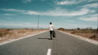 Man walking along road video