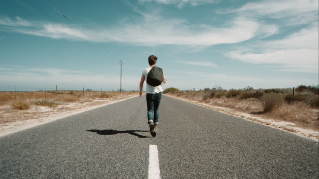 Man walking along road video