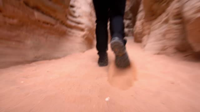 LA Man walking among sandstones at Pariah video
