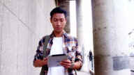A man walking and using a tablet computer video