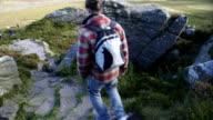 Man Walking Down a Cliff video